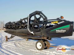 Good used 2016 MacDon FD75-D 40' flex draper header for sale at Combine World in Saskatchewan. Cross auger, transport, DKD, for CNH; JD, Agco, Class kits available. (Front LHS corner, full view, shorter angle. Main image.)