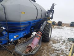 """Loading auger for sale at Combine World. from a NH SC430 air cart. 10"""" diameter. Also fits Flexi-Coil 3450. Sold with warranty."""