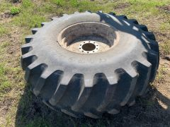 Set of four 23.1x26 tires on RoGator 500-series (554) rims. Bias, 12 ply, traction tread, tubeless, avg. 7/10.