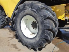 900/60R32 Michelin Mega X Bib tire. Radial, 176A8 rating, tubeless, traction tread, tire only, RHS, 7/10.