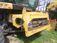 Good used complete feederhouse with lateral tilt off a Lexion 750R/750TT combine salvage part for sale at Combine World in Saskatchewan.  Damage to feederhouse floor & feederchain. As is.