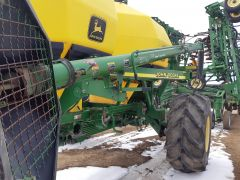 """7"""" loading auger assembly for John Deere 1900/1910 air cart. From a JD 1900.  With hopper, flighting & hydraulic components."""