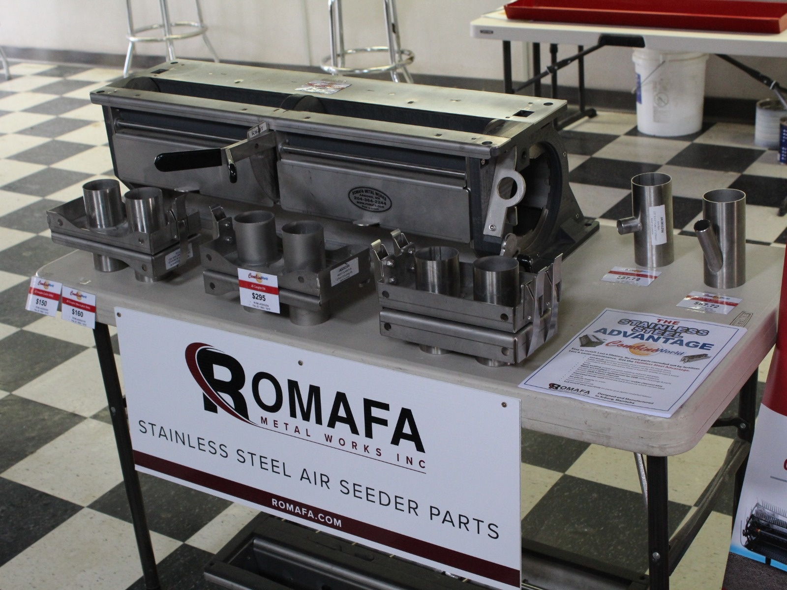 A display of Romafa's stainless steel air cart and air drill parts at Combine World Saskatchewan in Elstow/Saskatoon.